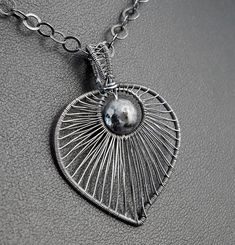 Sterling Silver pendant with Larvikite / wire wrapped /