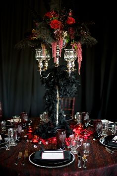 dramatic centerpiece/table setting  www.tablescapesbydesign.com https://www.facebook.com/pages/Tablescapes-By-Design/129811416695