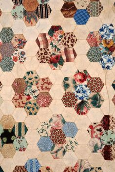 Detail of a 19th century patchwork bedcover from Cardiff. Mostly made from cotton chintzes.