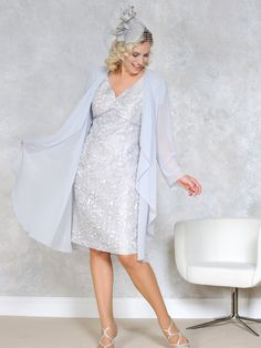 A stunning Mother of the Bride & Mother of the Groom dress from the Dressed Up Plus Size Spring/Summer 2015 Collection from Dress Code by Veromia. Colour: Pale blue/light grey/white. Paired with a long sheer throw/jacket. Product code DU68.  View more Mother of the Bride / Groom dresses from our Dress Code by Veromia collection at: http://www.baroqueboutique.co.uk/mother-of-the-bride-south-wales/  Photographs courtesy of: http://veromia.co.uk/Mother-of-the-Bride.html