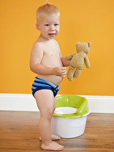 If your child is still attached to his comfort item, let him take that to the potty with him. It will give him a sense of security as he moves into this next big step.