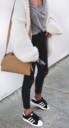 street style. black ripped jeans. grey tee. fluffy cardigan. adidas sneakers.
