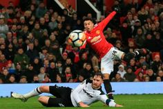 Manchester United's English midfielder Jesse Lingard has a shot but doesn't score during the English FA Cup third round football match between...