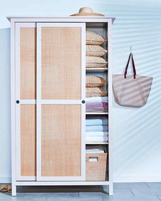 raffia paneled doors MATERIALS IKEA Hemnes wardrobe — Yellow, $379, ikea.com Cane & Basket Supply Co. Fine close-woven raffia cloth, $12.50 for a 2'-by-6' sheet, caneandbasket.com 3M Super 77 multipurpose spray adhesive, $10.98, homedepot.com Scissors STEPS Trim raffia fabric to fit the surface you want to cover (be it a panel or even a tray). Spray the back of the fabric with adhesive, press it evenly onto the surface, and let it dry completely.