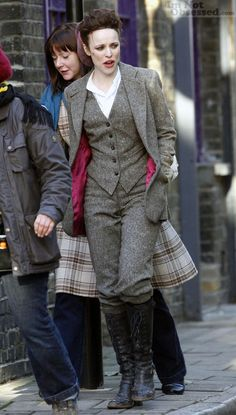 Rachel McAdams on the set of Sherlock Holmes, wearing a 3-piece tweed suit w/ red lining.