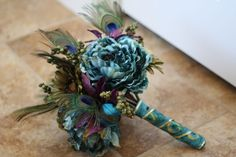 New Wedding Bouquets Purple Teal Peacock Theme Ideas Teal Bouquet, Purple Wedding Bouquets, Prom Flowers, Peacock Wedding, Bridesmaid Bouquet, Wedding Flowers, Feather Bouquet, Trendy Wedding, Fall Wedding
