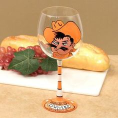 Oklahoma State Cowboys Ncaa Pair Of Hand Painted 16Oz. Wine Glass (Set Of 2) by Wine Things. $60.95. Brand New. Enjoy your favorite beverage with this pair of hand painted 16oz. wine glasses! They are adorned with the official school colors and comes packaged in a protective case for easy storage.. Save 21%!