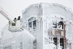 Firefighters spray down hot spots on an ice covered warehouse that caught fire in Chicago, USA, on January 23rd, 2013. The temperatures were well below freezing and the spray from the fire hoses encased everything below in ice, including buildings, vehicles, and some firefighting gear.