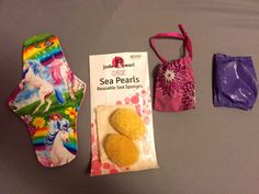 The cloth pad, sea sponges, Diva Cup bag, and Softcup package