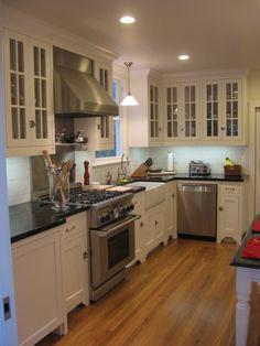 kitchens - glass-front white maple kitchen cabinets Absolute black granite countertops stainless steel backsplash farmhouse sink subway tiles backsplash  #CambriaQuartz
