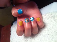 Yellow blue chevron flowery nails.. Nails by Missy