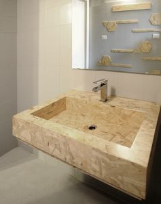 The challenge of domECO designers was to push the boundary of OSB everyday application and create a sink made out exclusively of chipboard panel
