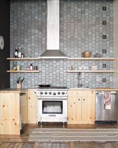 kitchen renovation inspiration - grey tiles and exposed wood cabinets
