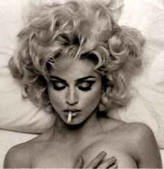 Love her make up here!  Not so much the cigarette or the fact that she appears to be naked, but her make up is to die for!  I may also be jealous of her eyebrows...