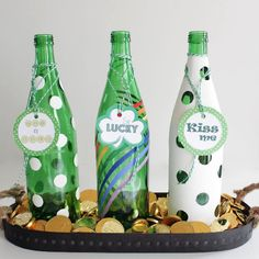 Give glass bottles a fun twist with paint and tags. Use them to decorate for just about any holiday, here all dressed up for St. Patty's day