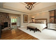 Like the way the carpet is situated around the bed, but the room is hardwood.
