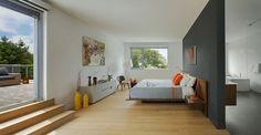 //臥室  Guest bedroom with a walnut bed frame and a private deck