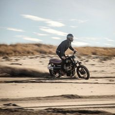 caferacersofinstagram: @aussiedix carving sand castles down...  caferacersofinstagram:  @aussiedix carving sand castles down the worlds longest beach on the #BCbuilt Dirt Bike.  CROIG Takeover with @british_customs Part II with photos from @thedeuk.  #BCbuilt #newheritage #croig #raen #campvibes #croigtakeover #caferacersofinstagram (at CROIG Takeover: British Customs Part II)