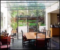 Modern Glass Extensions and frameless glazing