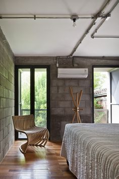 bedroom with exposed brick walls - loft vasco - porto alegre brazil - urbana arquitetura - photo by marcelo donadussi