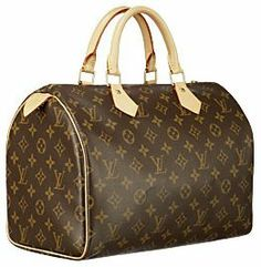 Louis Vuitton Speedy 30 top handle bag.- My first Louis Vuitton purchased from Neiman Marcus in 1988 and it looks the same now. Classic bags are a good purchase because they never go out of style.