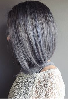 Now this is chic and so new and now – silver gray hair with hints of blue. Not for everyone, but defninitely for those wanting to be fashion forward. Color by Chris Weber.