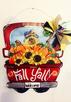 I painted this fall truck door hanger with pumpkins, sunflowers and a scarecrow. Sunflower Door Hanger, Pumpkin Door Hanger, Fall Crafts, Halloween Crafts, Fall Wooden Door Hangers, Fall Canvas Art, Painting Burlap, Painted Wooden Signs, Thing 1