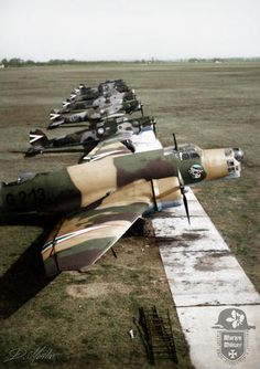 """1939 - Kecskemét (Hungary) Airfield Junkers Ju 86K-2 bomber of the 3/1 """"Arrow of God"""" Bombing Company, with Heinkel He 70K reconnaissance planes from the 1/2 """"Stork"""" Long-range Reconnaissance Company in the background. RHAF."""