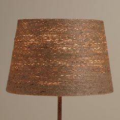 Artisans hand wrap our exclusive Twine-Wrapped Table Lamp Shade to create its uniquely rustic texture. Pair this versatile shade with any of our mix-and-match accent lamp bases to create the perfect eco-chic look in any small space in the home.