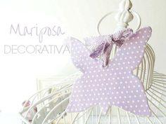 Mariposa decorativa hecha con decoupage