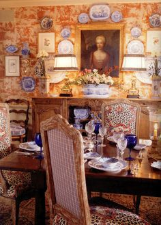Charles Faudree does the layered look with emphasis on toile wallpaper and transferware. So rich!!