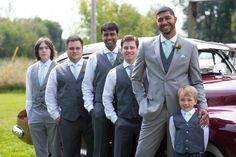 Groomsmen in mismatching patterned mint ties