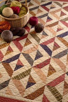 Martingale - Strip-Smart Quilts   I really like these fall colors alternated with the cream and the secondary design the blocks make.