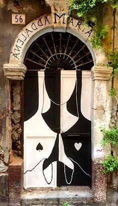 Beautiful painted door honoring Maria Maddalena (Roman Catholic) in Catania, Sicily, Italy.