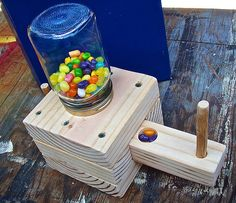 You can make this fun wooden dispenser for jelly beans, gumballs or any other hard candy that will fit in it.