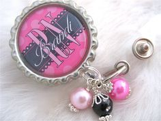 Personalized Nurse ID Badge Reel or Keychain RN Np Lmt  Nicu Hot Pink and Black polka dot Bottle cap Jewelry Necklace Holder Pull ID Clip. $17.50, via Etsy.