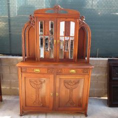 This is a gorgeous French antique Art Nouveau hand carved hutch that is made out of solid oak and dates from 1900-1910. Description from rubylane.com. I searched for this on bing.com/images