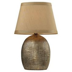"""Ceramic table lamp with a crocodile-inspired motif and tapered shade.   Product: Table lamp Construction Material: Ceramic and fabric Color: Meknes bronze and taupe Features: HandcraftedCrocodile-inspired motifUL and cUL listed Accommodates:  (1) 60 Watt medium base bulb - not included  Dimensions: 21"""" H x 13"""" Diameter"""