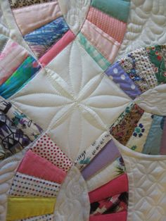 Antique Double Wedding Ring Quilt, finished and quilted by Esther at Threads on the floor:  At the intersection of the rings she did a simple continuous curve design, shown here.