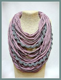 This feminine & easy to wear necklace that ties around the neck with a ribbon, is made with pink T-shirt yarn and grey cotton & silk cords.  Its length can be increased by tying the ribbon loosely.   It is lightweight and soft, so very comfortable and easy to wear & best solution for women with metal allergy.  It is perfect as a present and comes beautifully gift wrapped in a cute handmade cotton bag.   It is perfect as a present and comes beautifully gift wrapped in a cute handma...
