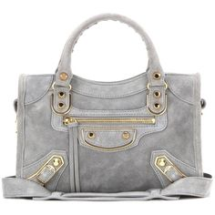 6eb7e50542b5 Shop Classic Metallic Edge Mini City suede shoulder bag presented at one of  the world s leading online stores for luxury fashion.