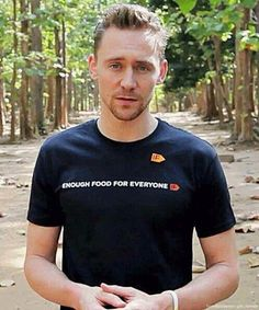 Tom on his trip with UNICEF. Ugh, that expression on his face!!