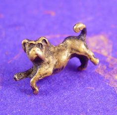Vintage DOG Tie Tack Whimsical animal figural novelty. What a comical little pup this is! He looks like he is ready to play! A perfect addition to a collection or a gift to that special someone. Maker: unknown Material: gold filled or brass Size: see photo Weight: light Condition: In good vintage pre-owned condition. Lovely patina! Boxed for gift giving; gift wrapped on request. These are part of a MASSIVE estate collection of cufflinks and jewelry so be sure to check out our other items ...