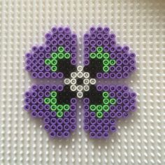 Pansy flower hama beads by nytt_liv_til_hjemmet Easy Perler Bead Patterns, Bead Loom Patterns, Flower Patterns, Beading Patterns, Fuse Beads, Pearler Beads, Bead Crafts, Diy Crafts, Pixel Pattern