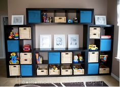 want this for our living room books blurays tv etc! Ikea Expedit Shelves - Look how there are four sets of shelves put together to create this look.