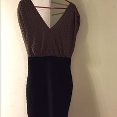 Express Dress...perfect for an evening wedding. Gold crocheted top that has a v in the front and back, with a black bottom. Fitted skirt with a blousier top. It's very comfortable!!! Express Dresses