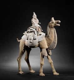 A very large pottery model of a camel and rider Tang Dynasty. 唐 陶胎彩繪胡人騎駱駝俑 Terracota, Taiwan, Chinese Arts And Crafts, Bactrian Camel, Airline Pet Carrier, The Han Dynasty, Art Chinois, Sculptures, Lion Sculpture