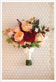 Adornments created this amazingly beautiful bouquet featuring David Austin English garden roses, Black Magic roses, and lamb's ear tied with an ivory silk ribbon | by Alchemy Fine Events www.alchemyfineevents.com