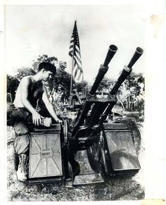 """1970- Soldier of the U.S. 1st Air Cavalry examines a captured Soviet-made anti-aircraft machine gun found with other prizes in """"The City's"""" weapons cache. """"The City"""", an area southwest of Snoul, was a two-square mile PAVN complex that contained over 400 thatched huts, storage sheds, and bunkers, each of which was packed with food, weapons, and ammunition."""