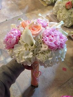 Peonies, calla lilies, peach roses boutquet